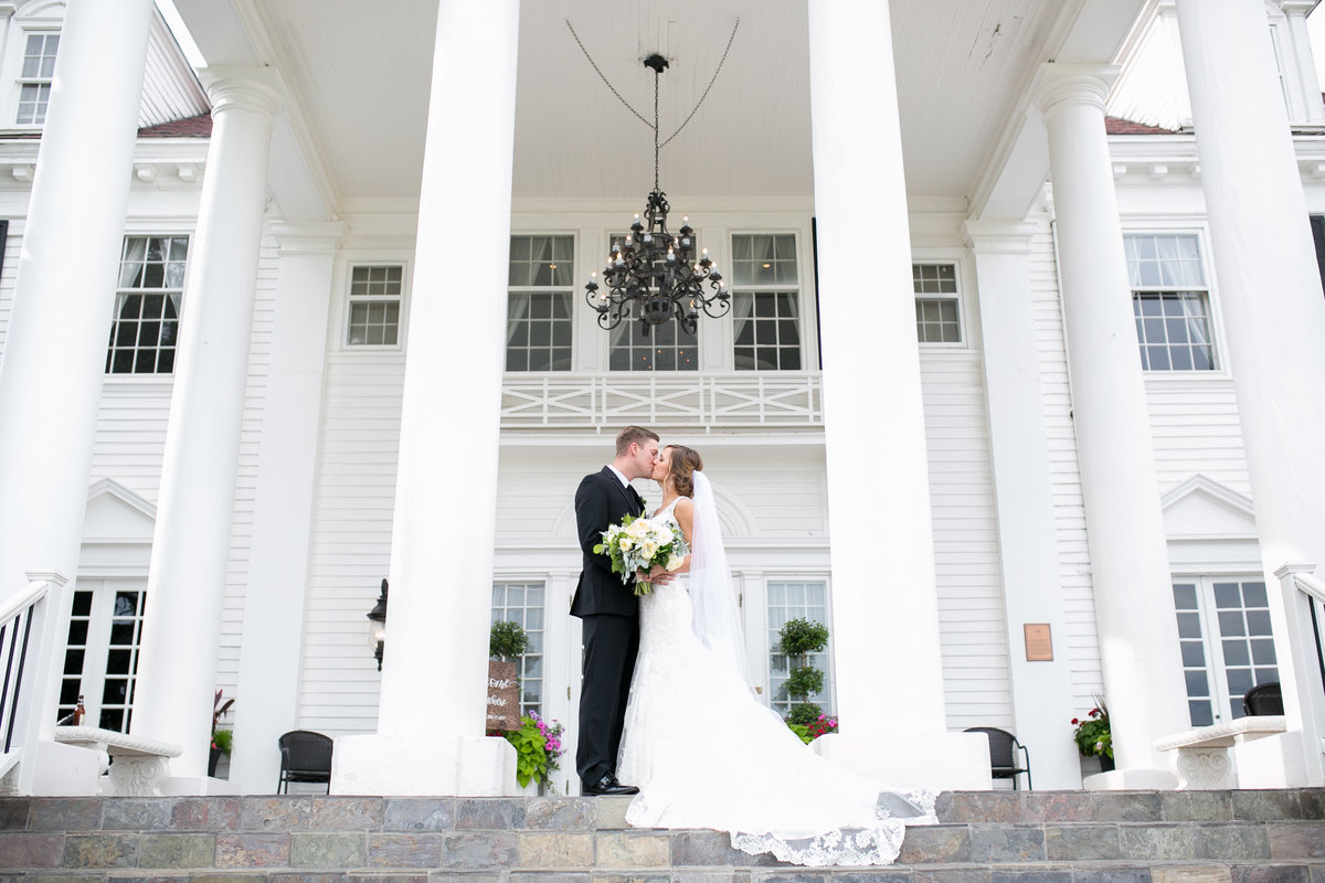 Bride and groom on the steps of the Manor House in Colorado