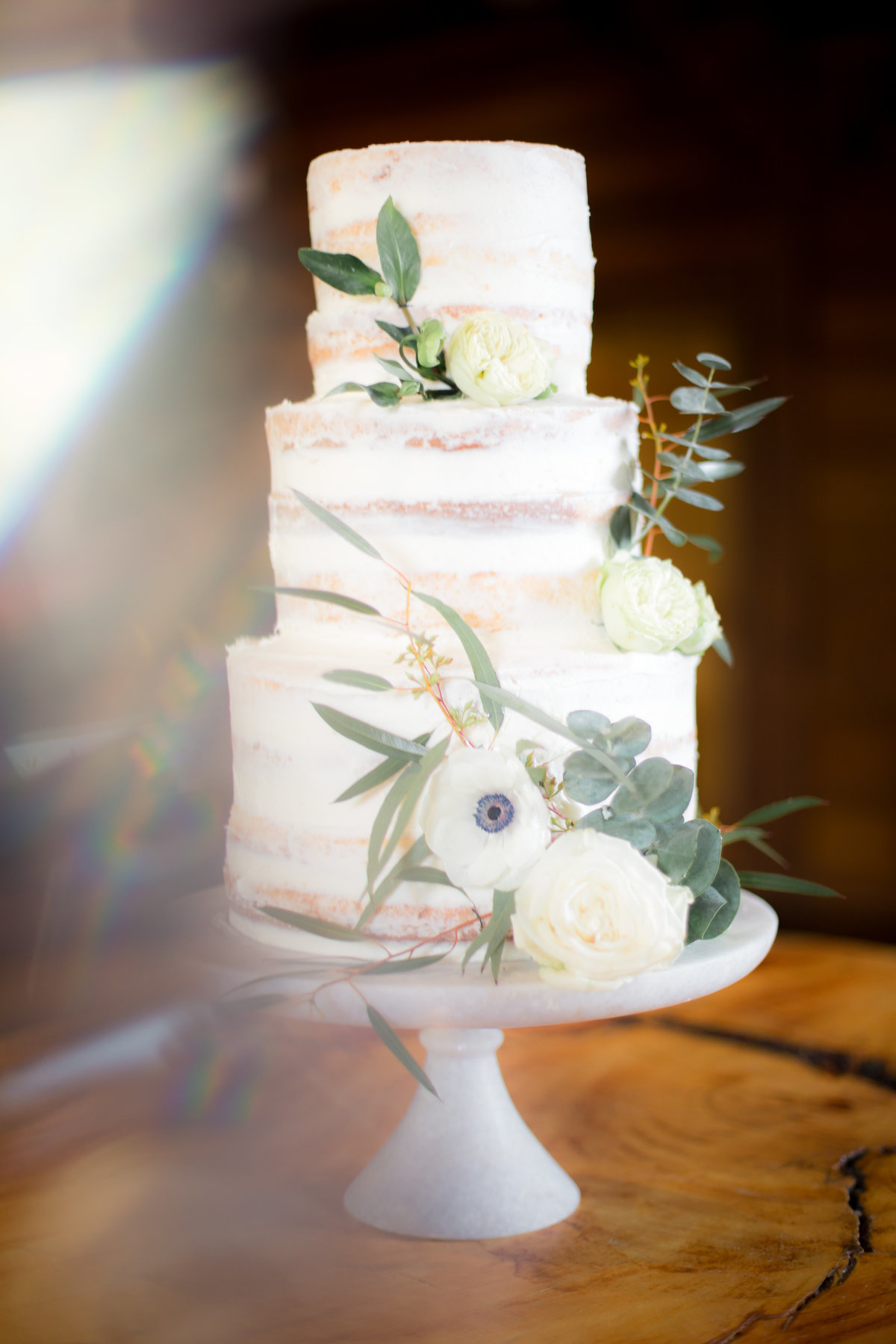trendy naked wedding cake with flowers