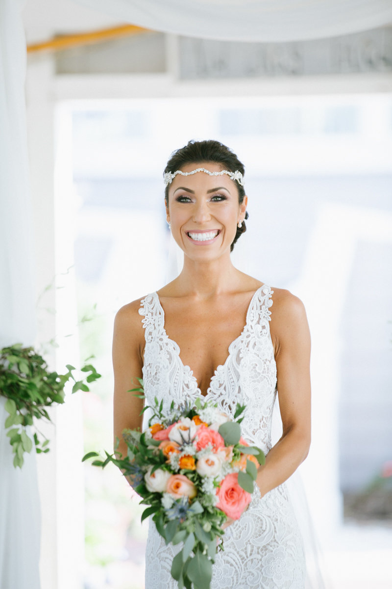 bride wearing a lazzarro wedding gown during her first look