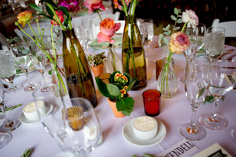 Granby-Colorado-Strawberry-Creek-Ranch-Wedding-Fire-on-the-Mountain-Wedding-Pops-of-Color-Fire-hot-colors-florals-on-table