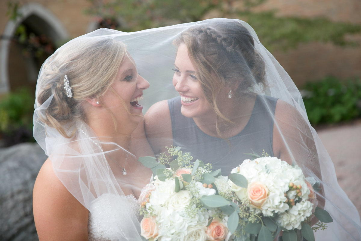 Bride and sister moment on wedding day