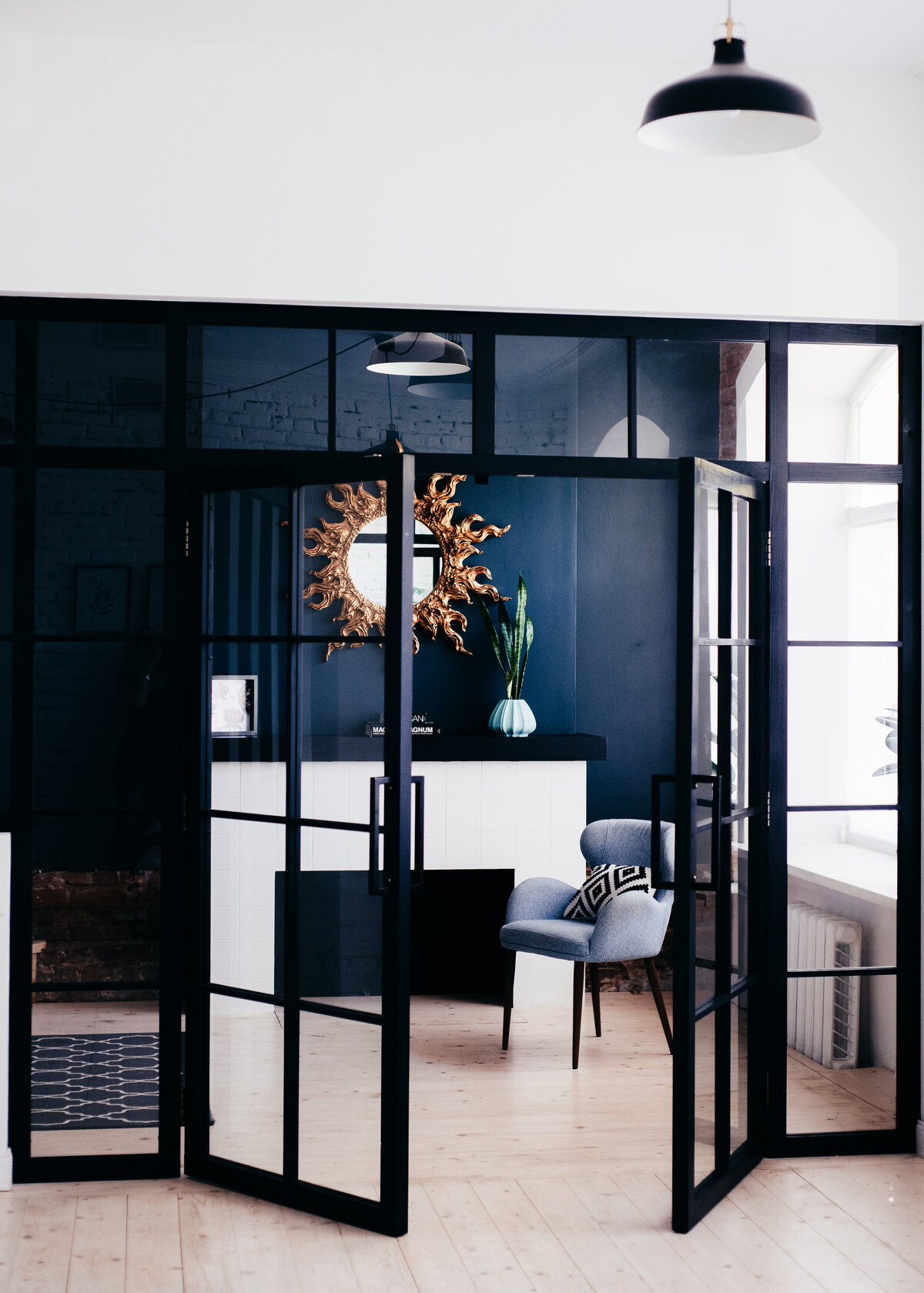 Navy painted home office with black crittal doors styled by an interior designer.
