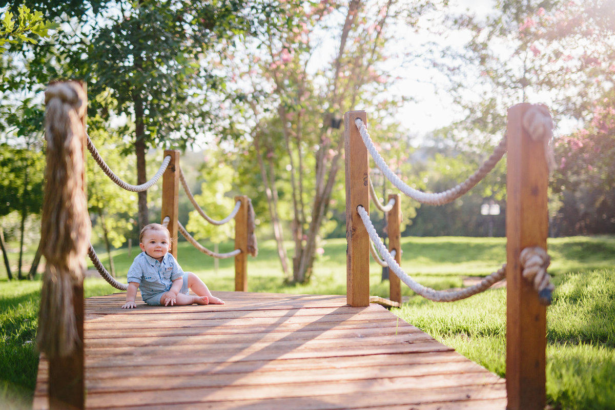 portrait of baby crawling on a bridge by San Antonio photographer Expose The Heart