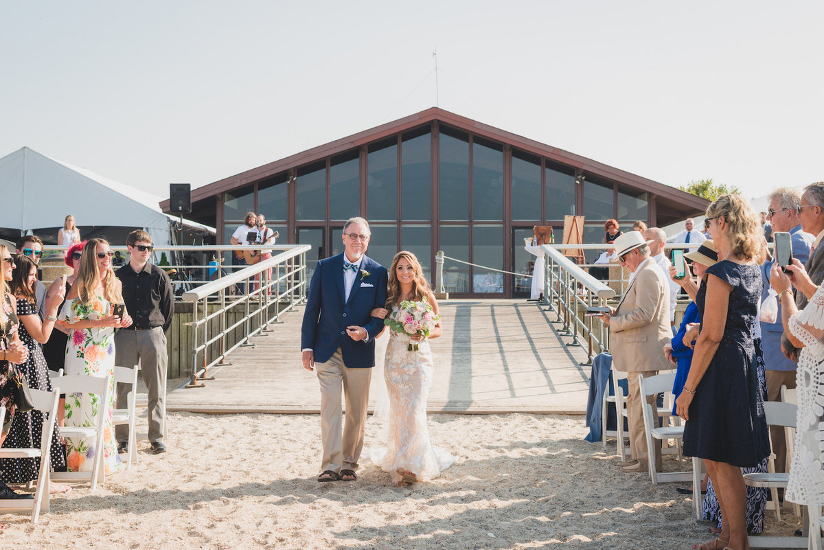 photo of dad walking bride down the aisle at beach ceremony wedding at Pavilion at Sunken Meadow