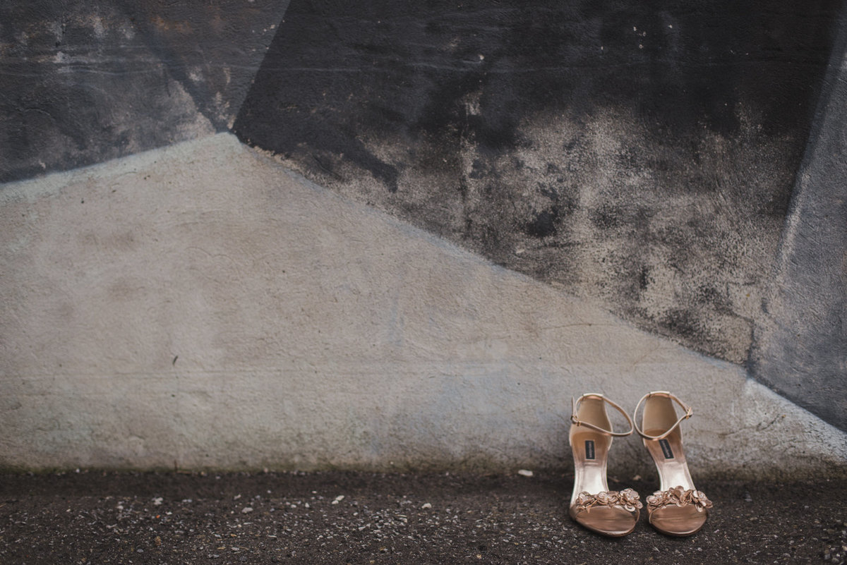 wedding shoes against monochrome wall