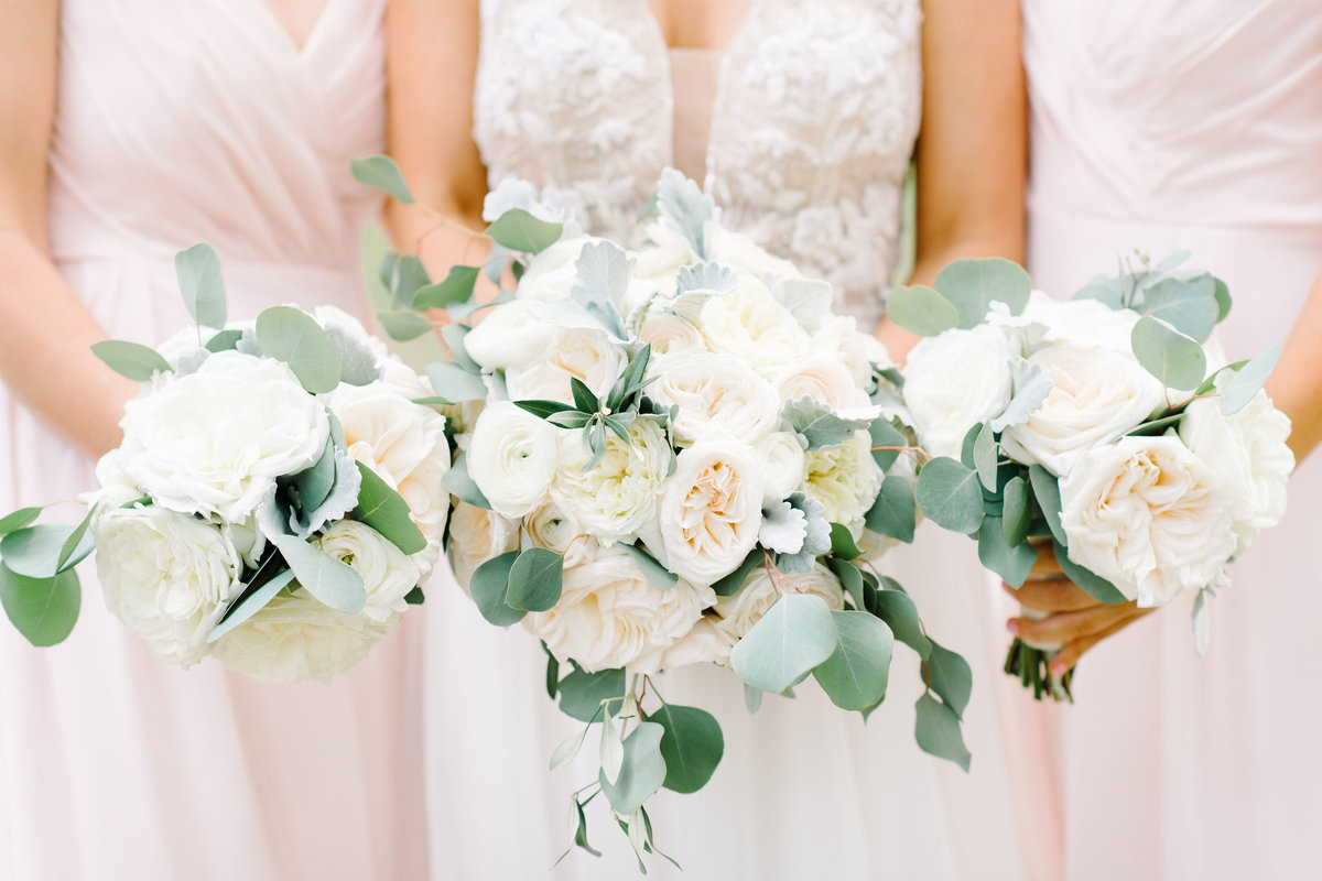 Bride and Bridesmaids in Blush Pink Dresses Holding Ivory White Blush Greenery Bouquets