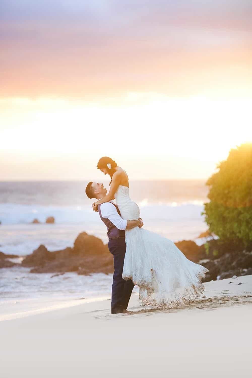 Groom lifting bride in the air after their Maui elopement