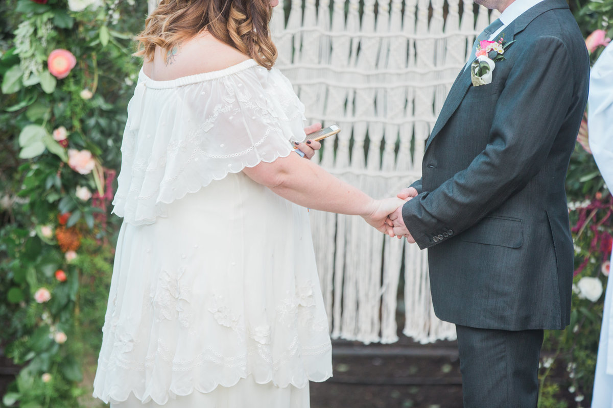 Bride and groom holding hands during ceremony at Madrona Manor in Healdsburg California