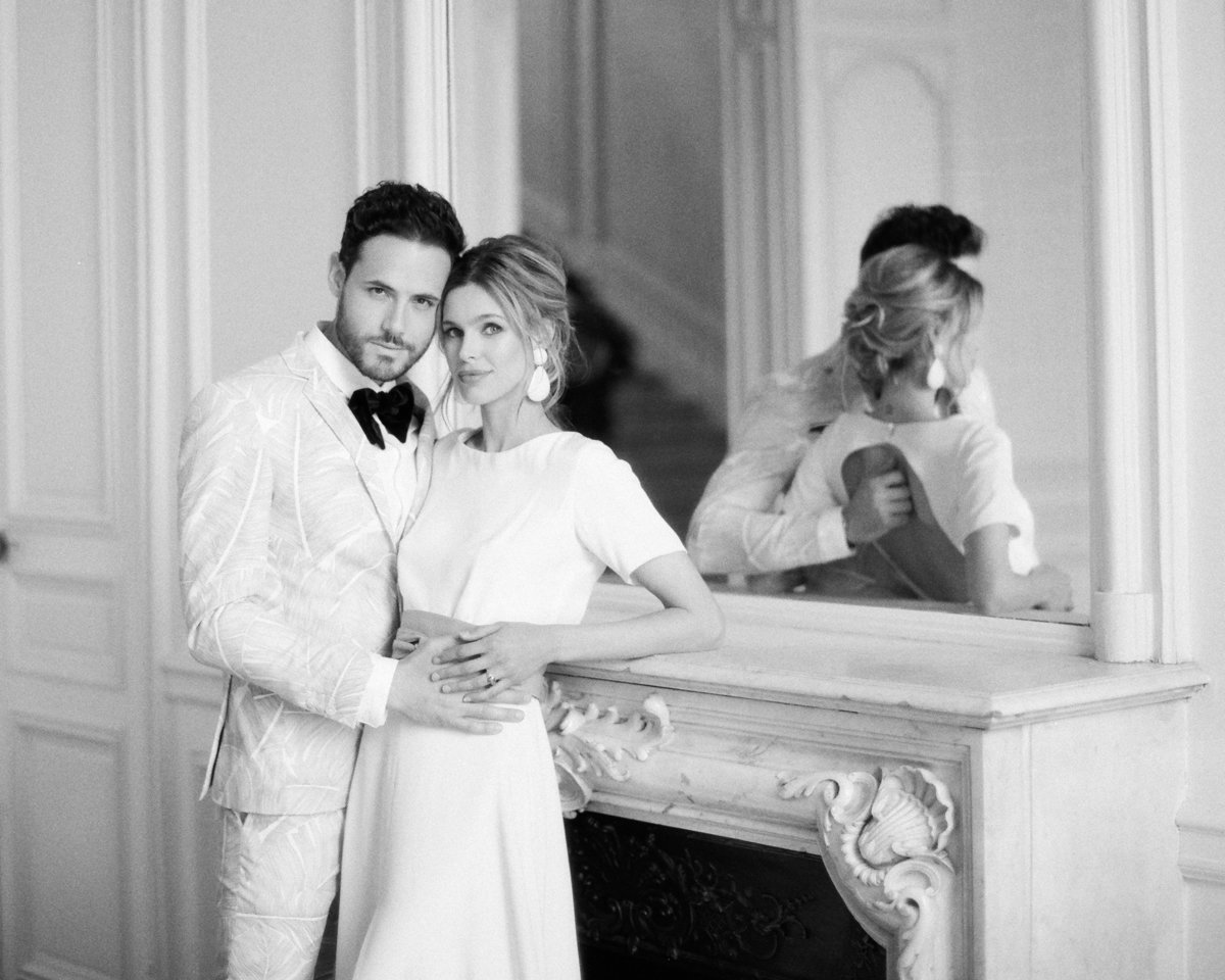 Young couple embrace in French chateau during elopement