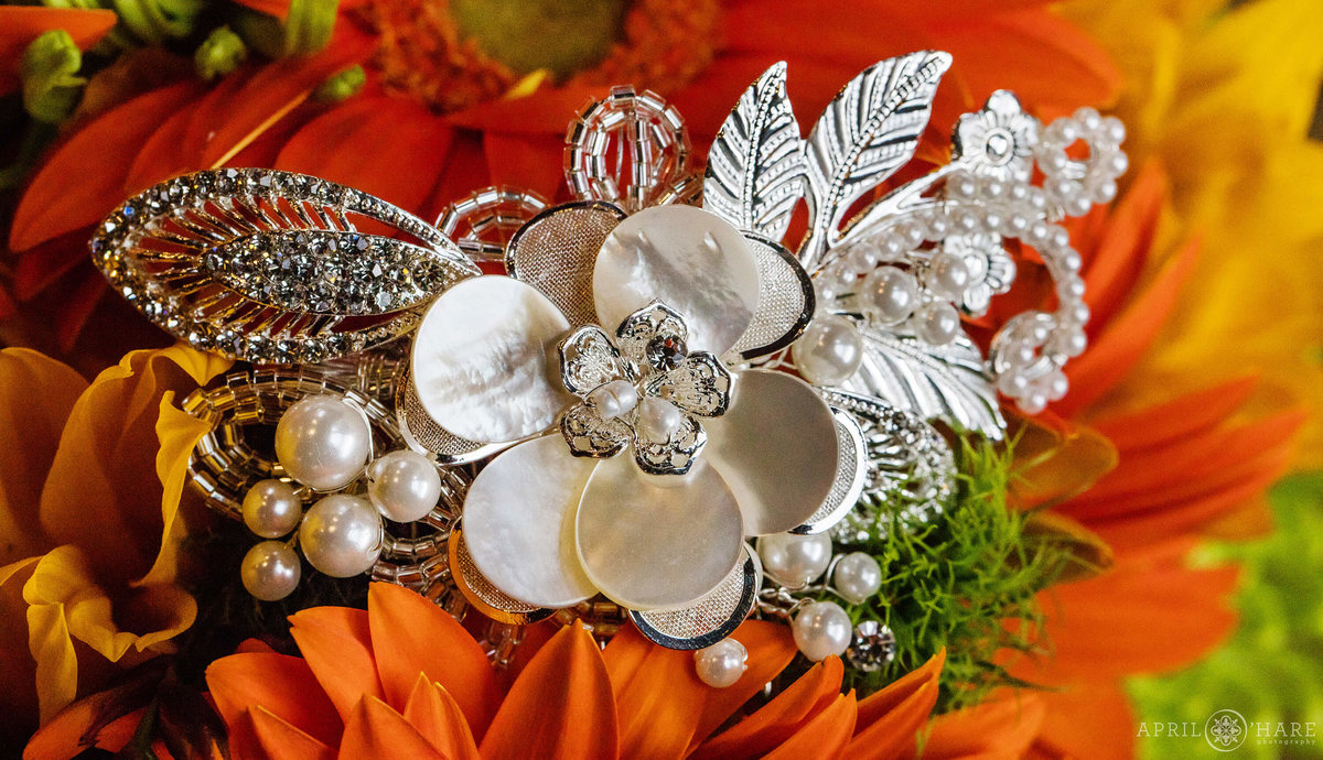 Pretty fall wedding detail flowers with jeweled hair piece in Colorado