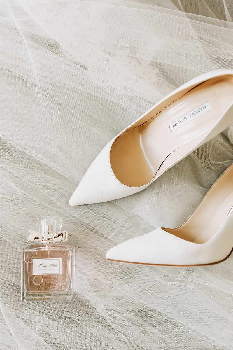 Perfume, veil and wedding shoes