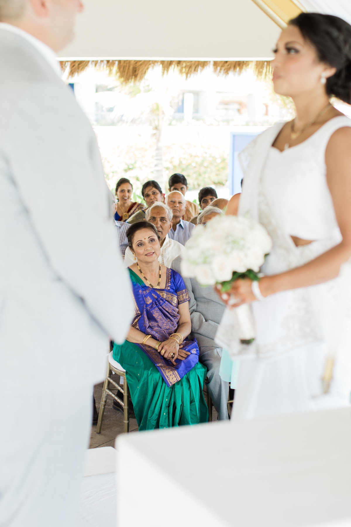 A tearful mother looks on as her daughter commits to her husband.  Photograph taken by Rebecca Cerasani