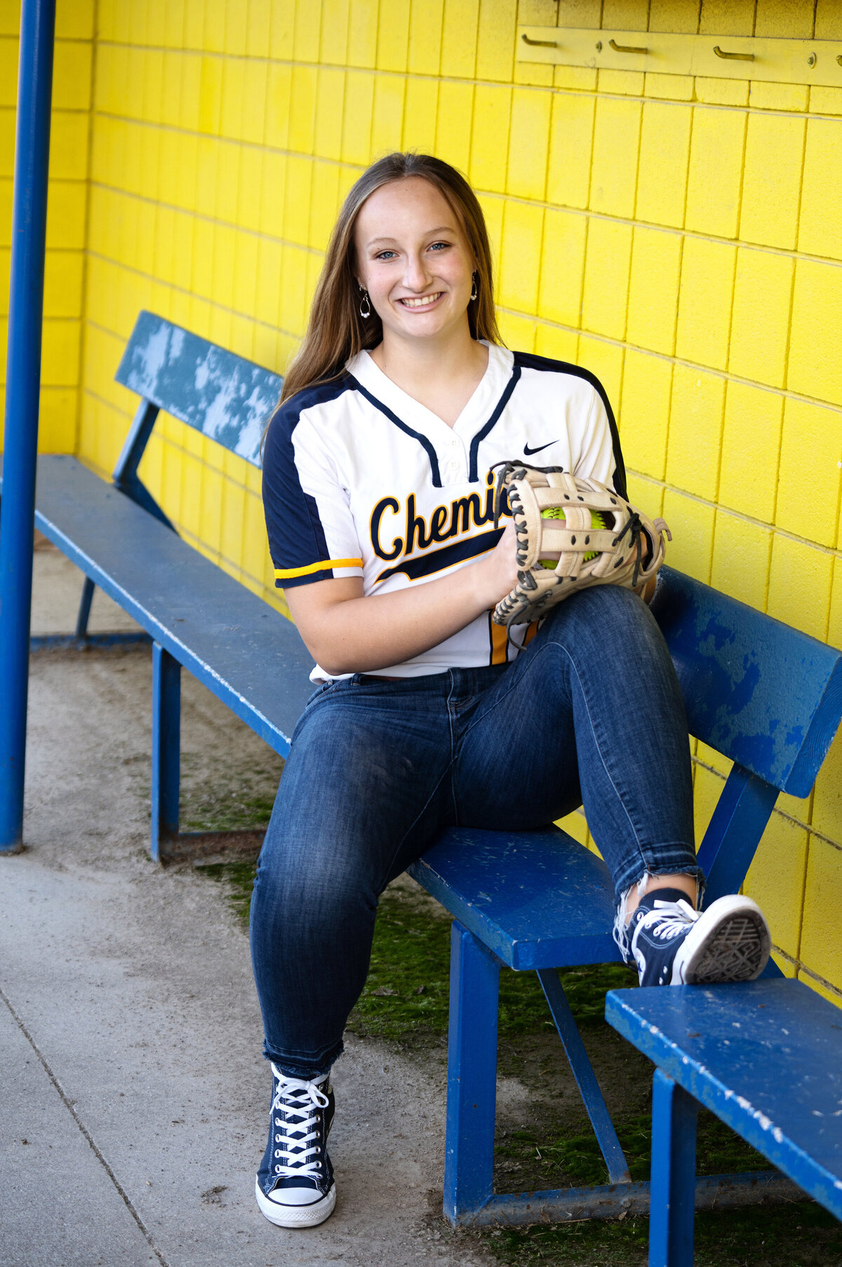 softball player in dugout