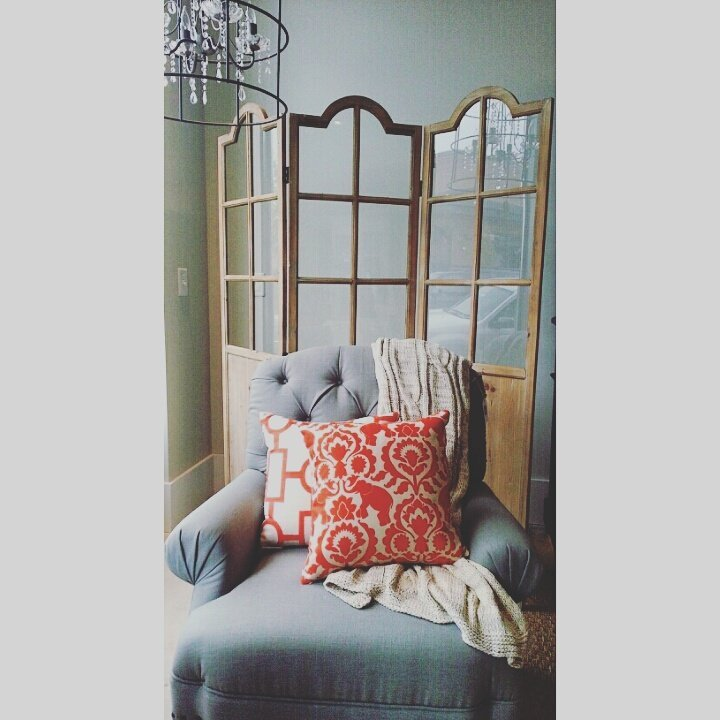 upholstered gray chair and pillow