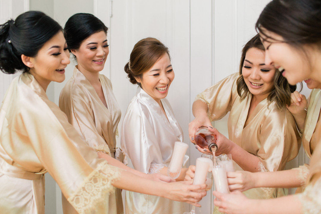 Atlanta bride toasts with bridesmaids