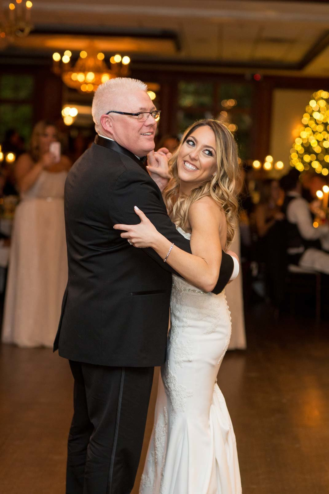 Bride dancing with her dad at The Mansion at Oyster Bay