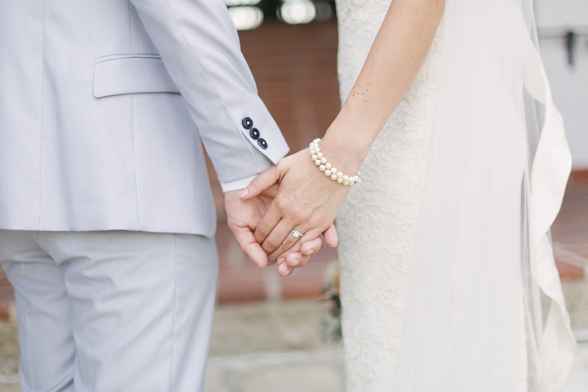 Bride and groom hold hands at Santa Barbara Courthouse wedding