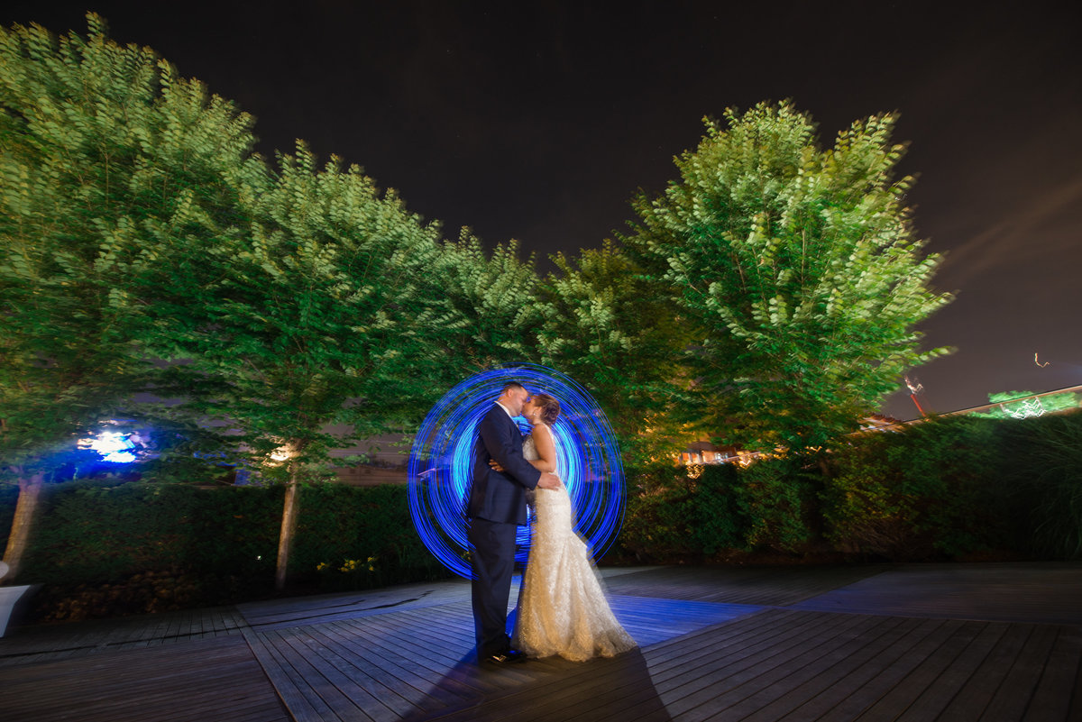 Night photo with bride and groom at Harbor club at prime with blue lights