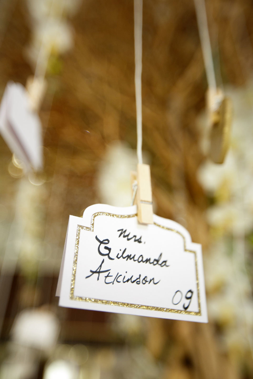 Wedding place card hanging from a tree