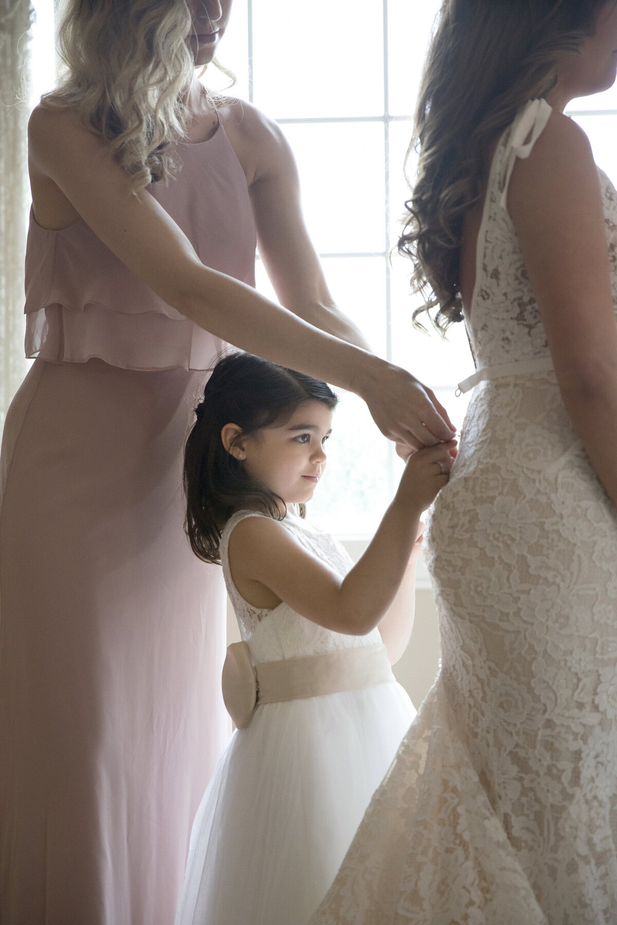 flower girl helping bride