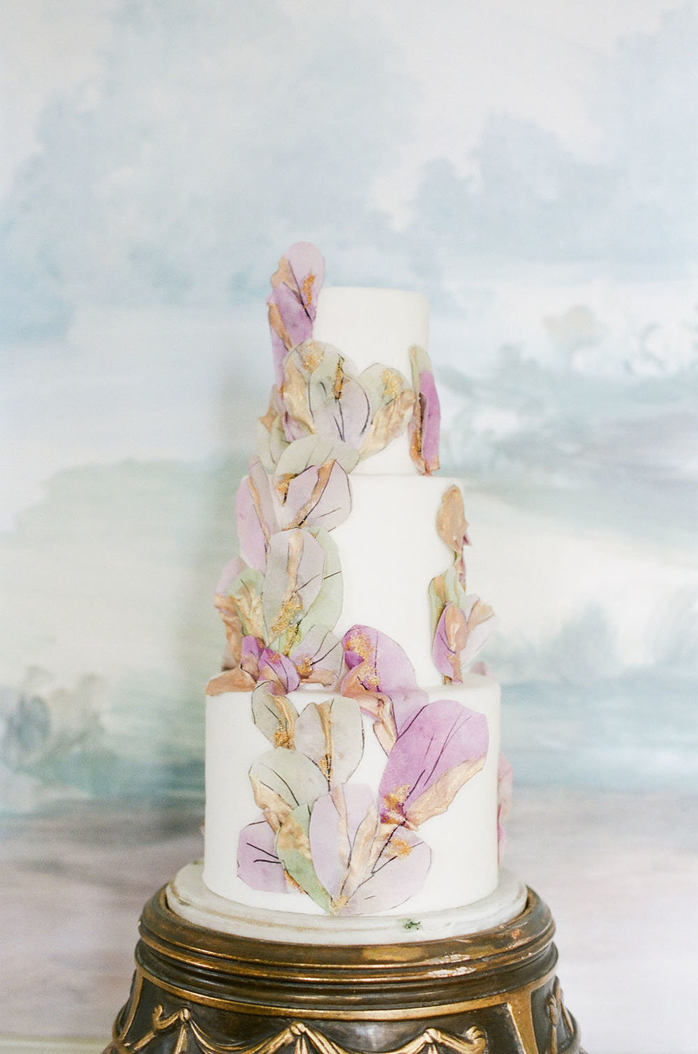 Fine art wedding cake with handpainted rice paper leaves in sage and lilac colors