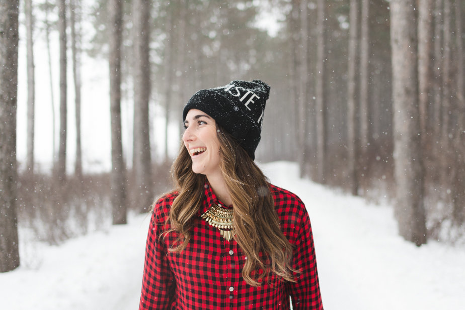 yoga teacher wearing Spiritual Gangster toque on a snowy path