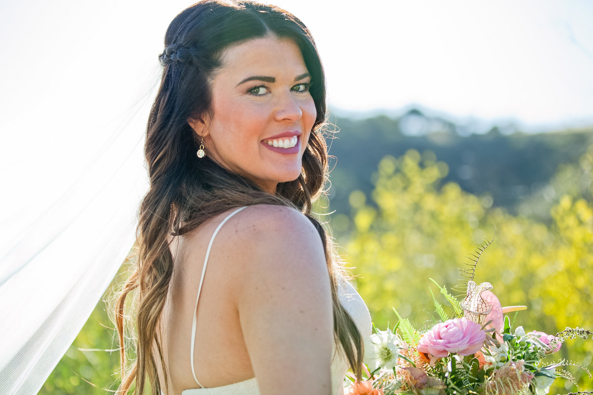 Romantic Spring Elopement  bride in field with Spring bouquet at Higuera Ranch  in San Luis Obispo  by Amy Britton Photography Photographer in St. Louis