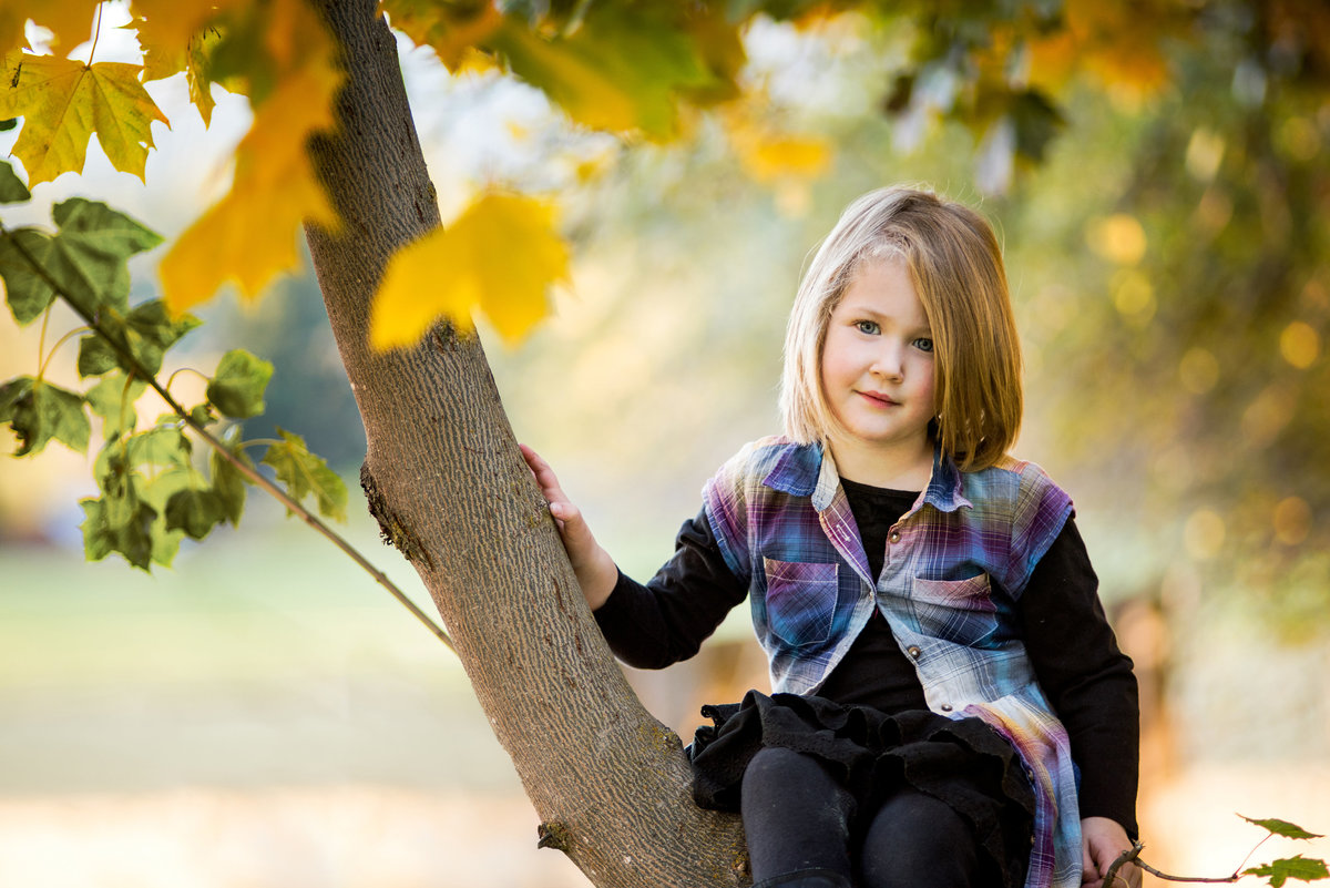 Photo of a young girl sitting  in tree Ellensburg Washington