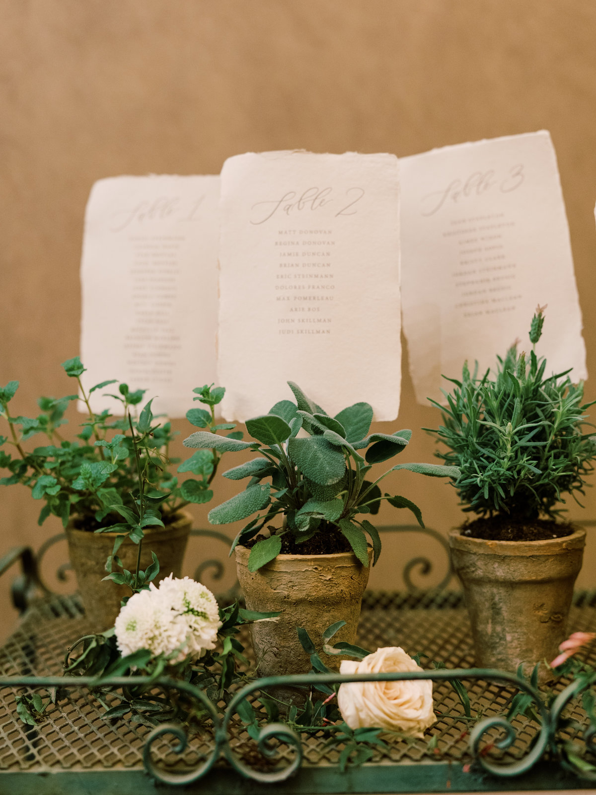 pots that are displaying table assignments for a wedding at Red Rock Casino in Las Vegas