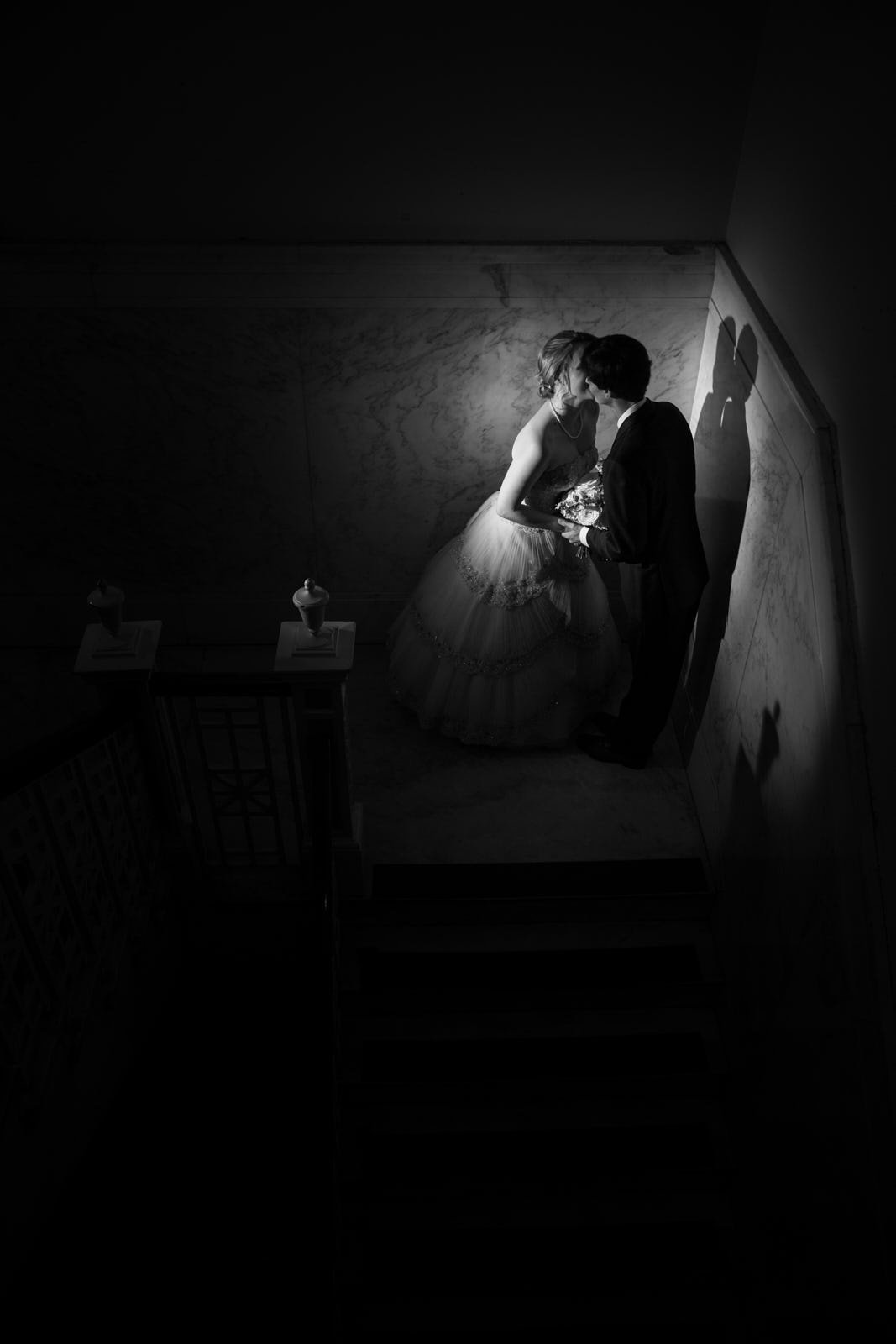 bride and groom kiss on stairs at Atlanta Historic Dekalb Courthouse wedding