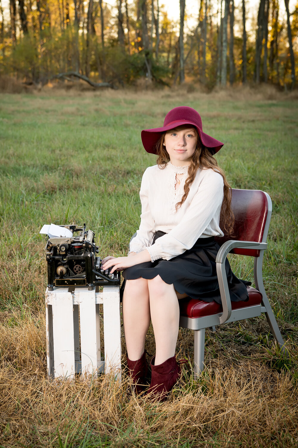 senior girl, field, vintage typewriter red hat old office chair