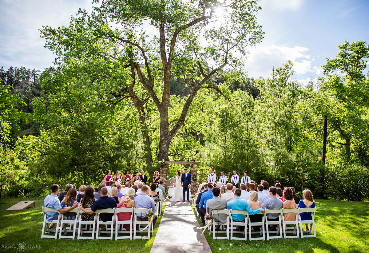 Beautiful outdoor ceremony at Wedgewood Weddings on Boulder Creek in Colorado