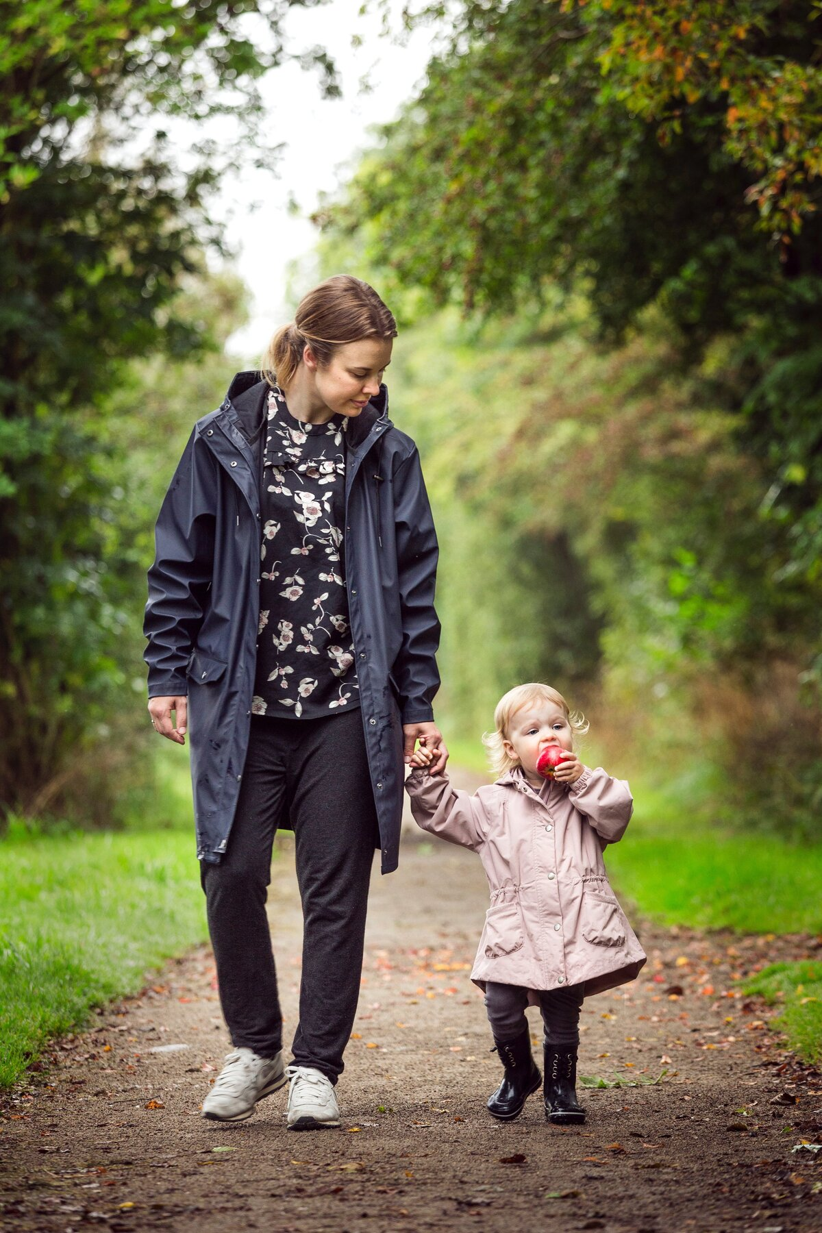 woman-walking-with-child-on-pathway-2505132