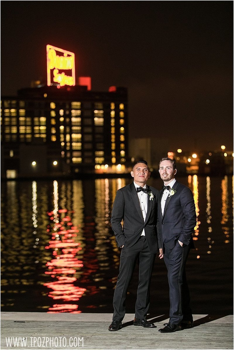 2 grooms same-sex wedding in Baltimore, under the Domino Sugar sign