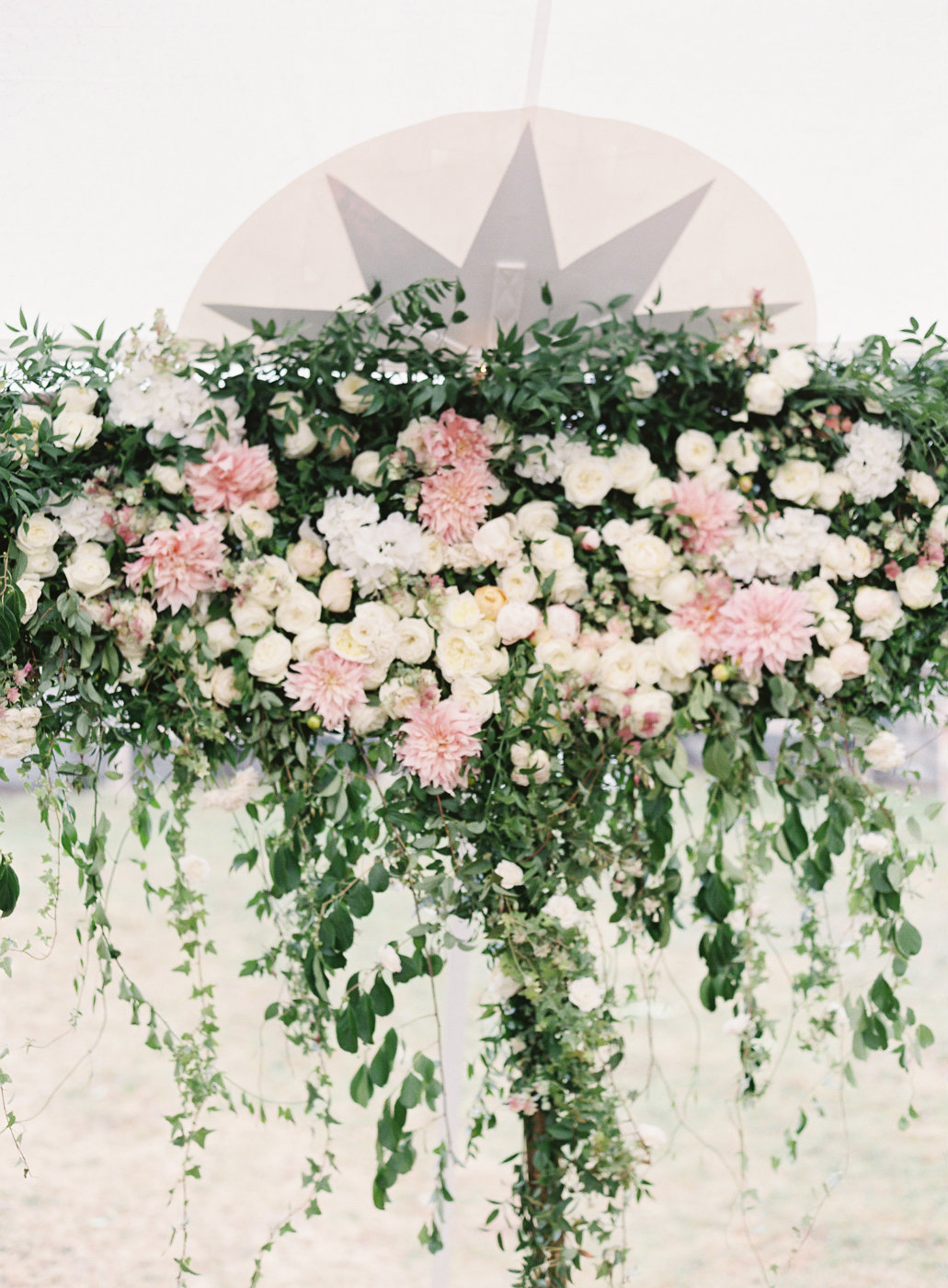 Blush and cream floral head table backdrop tent garden wedding.