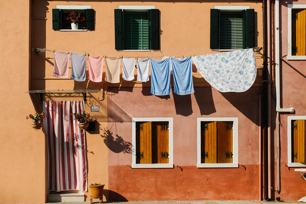 clothes on line on orange home Italy