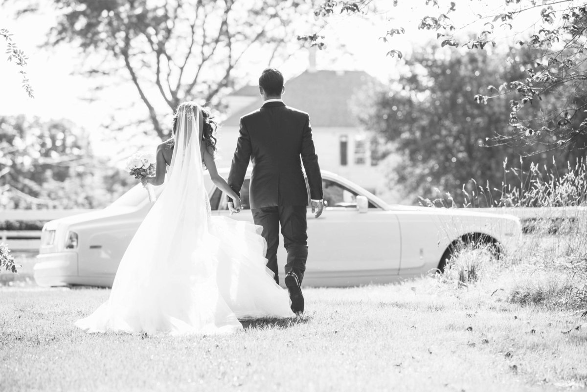 Bride and groom walking to the car at Giorgio's Baiting Hollow