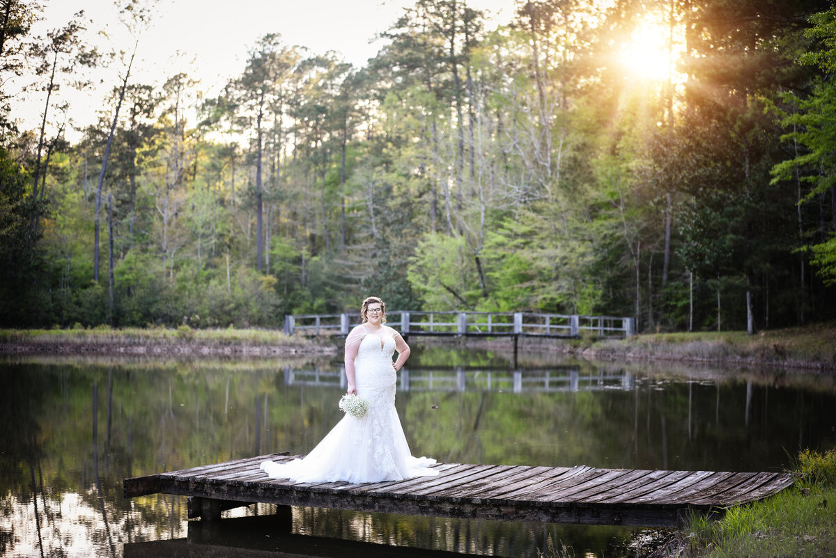 Beautiful bridal portrait photography: bride stands on an old bride on a pond, Mississippi Wedding Photography