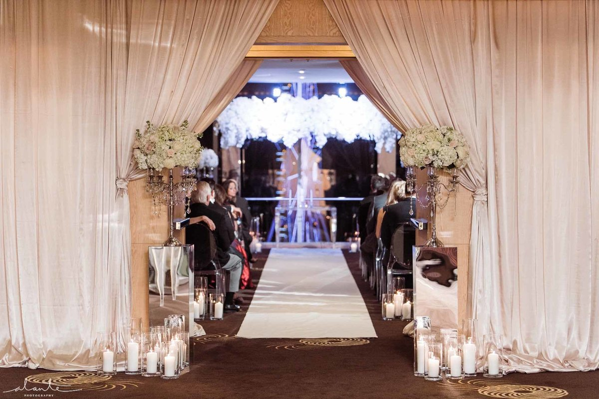 This Luxury wedding ceremony has it all, white pave flowers, mirrors, candles  and crystal everywhere.