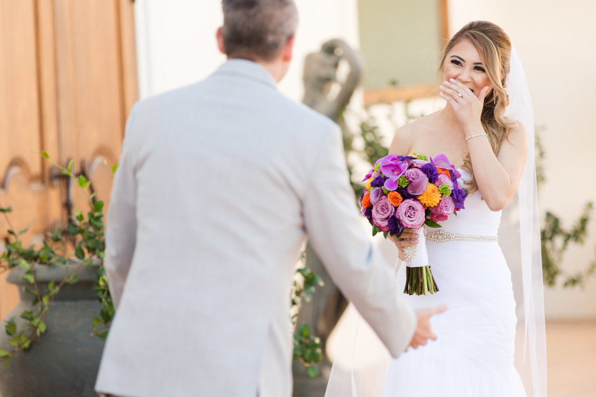 Bride holds back her tears as she sees her groom for the first time at villa de amore by matty fran photography