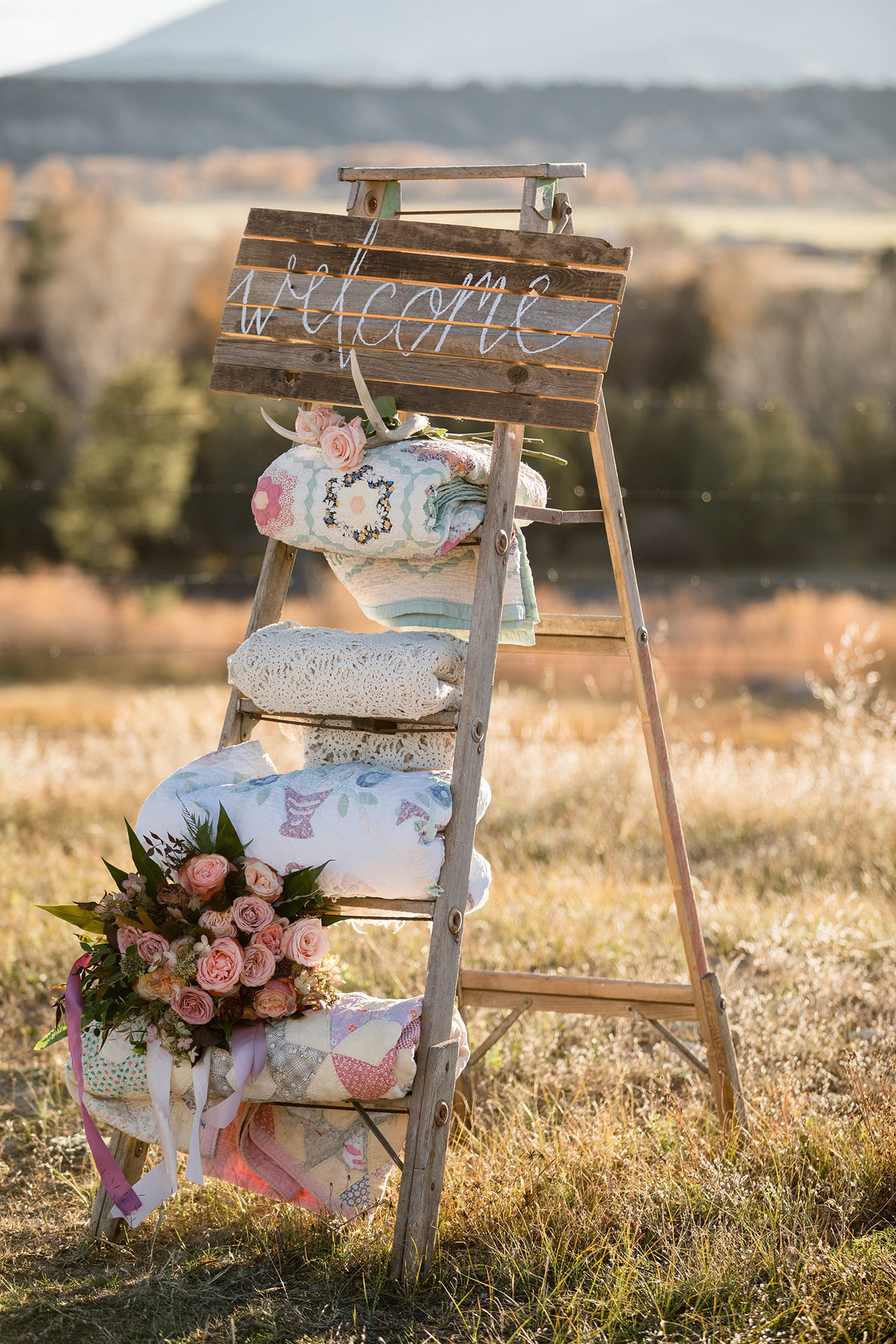 Everett Ranch Rocky Mountain Wedding Outdoor Barn Rustic Salida Colorado Alpaca Collegiate Peaks Vintage Ranch Fish Homemade Quilts Welcome Sign Fall Blush 012