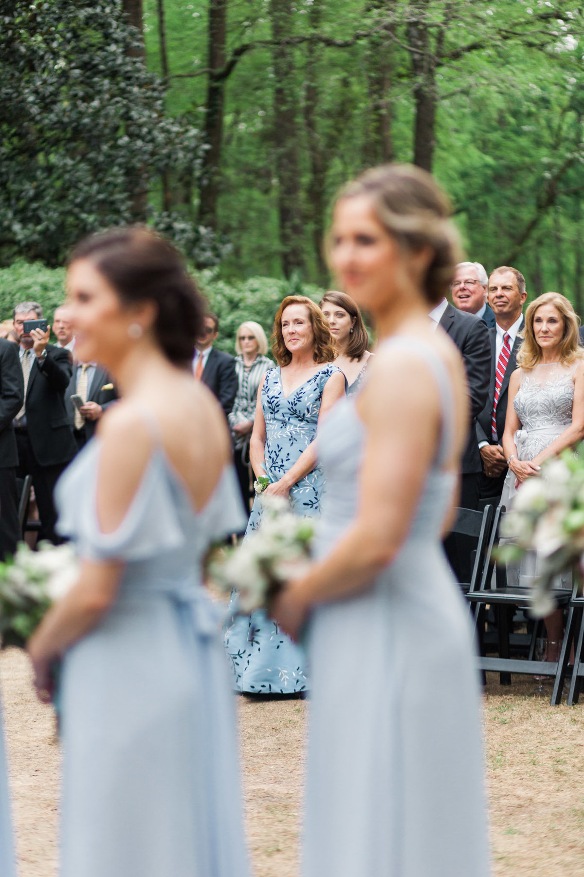 Mother of the bride watches as her daughter walks down the Swan House steps. Photo by luxury destination wedding photographer Rebecca Cerasani.