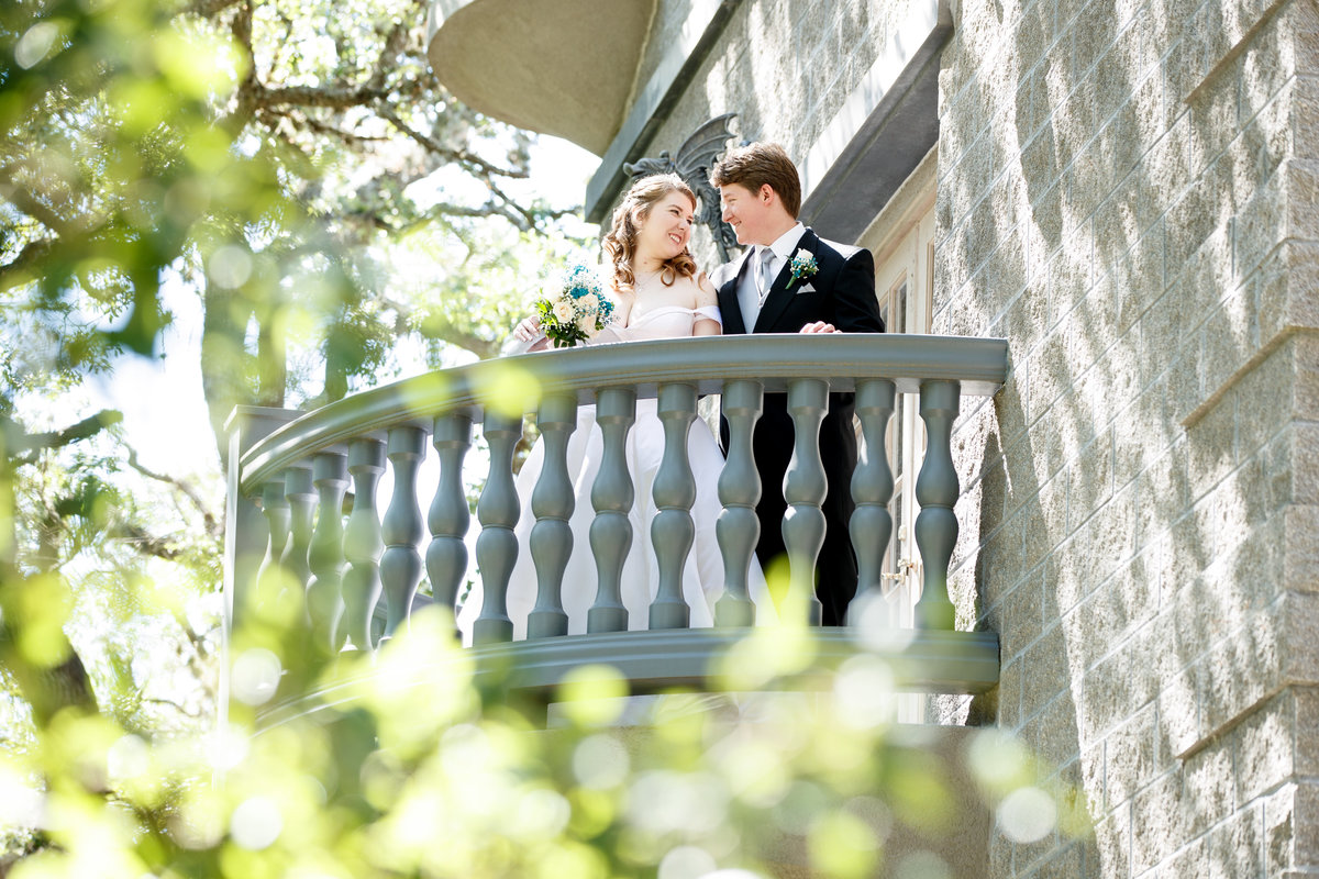 Austin wedding photographer castle avalon wedding photographer bride groom on balcony