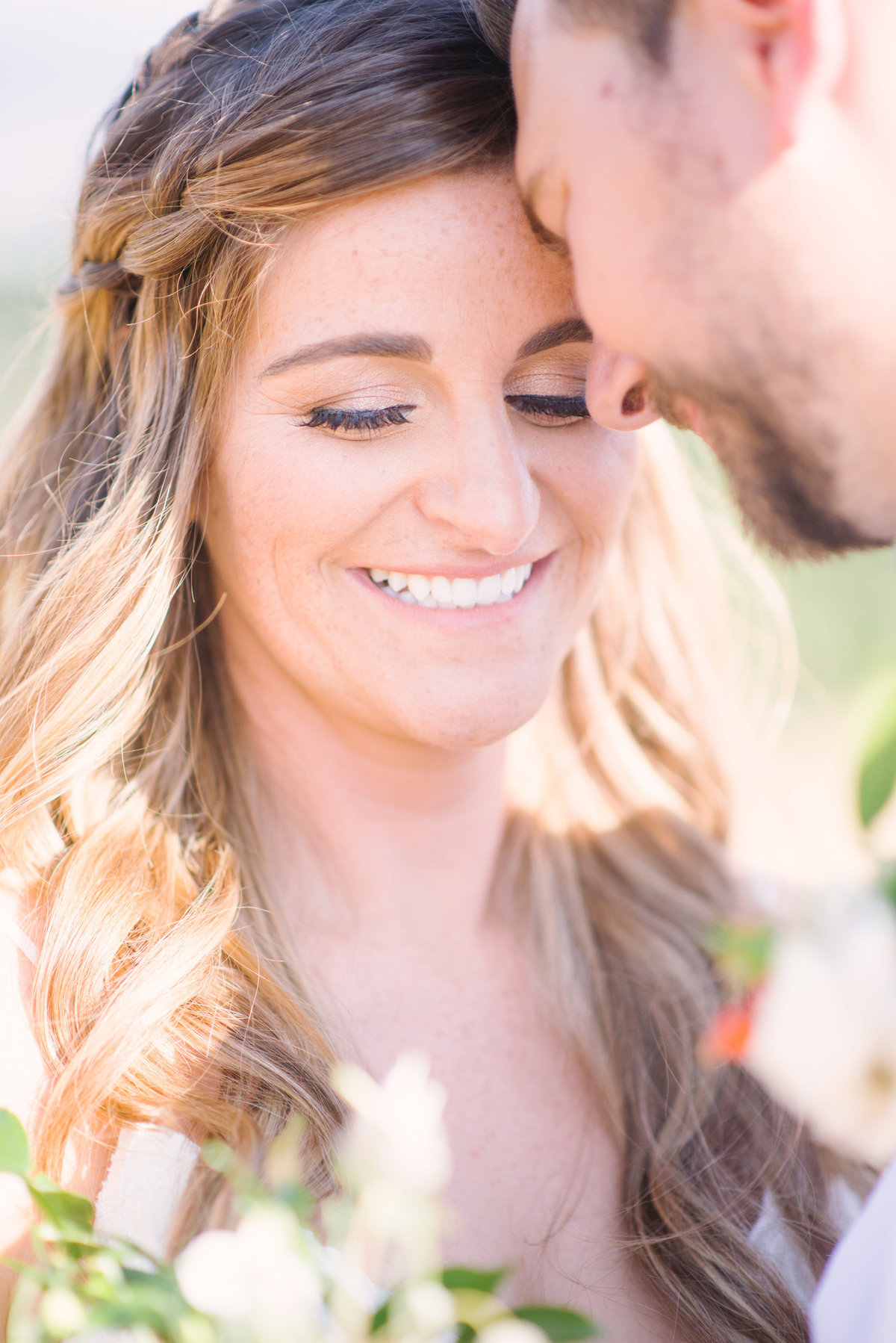Couple smiling at eachother on wedding day | Vancouver Wedding Photographer