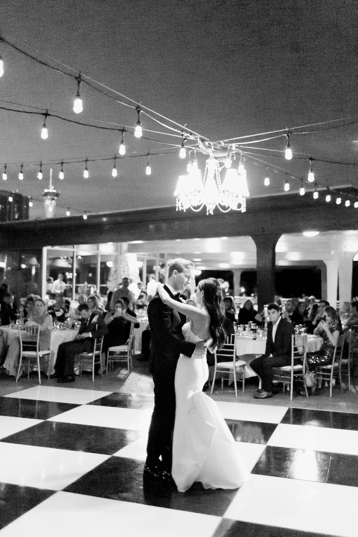 black and white checkered dance floor photo, bride and groom first dance photo