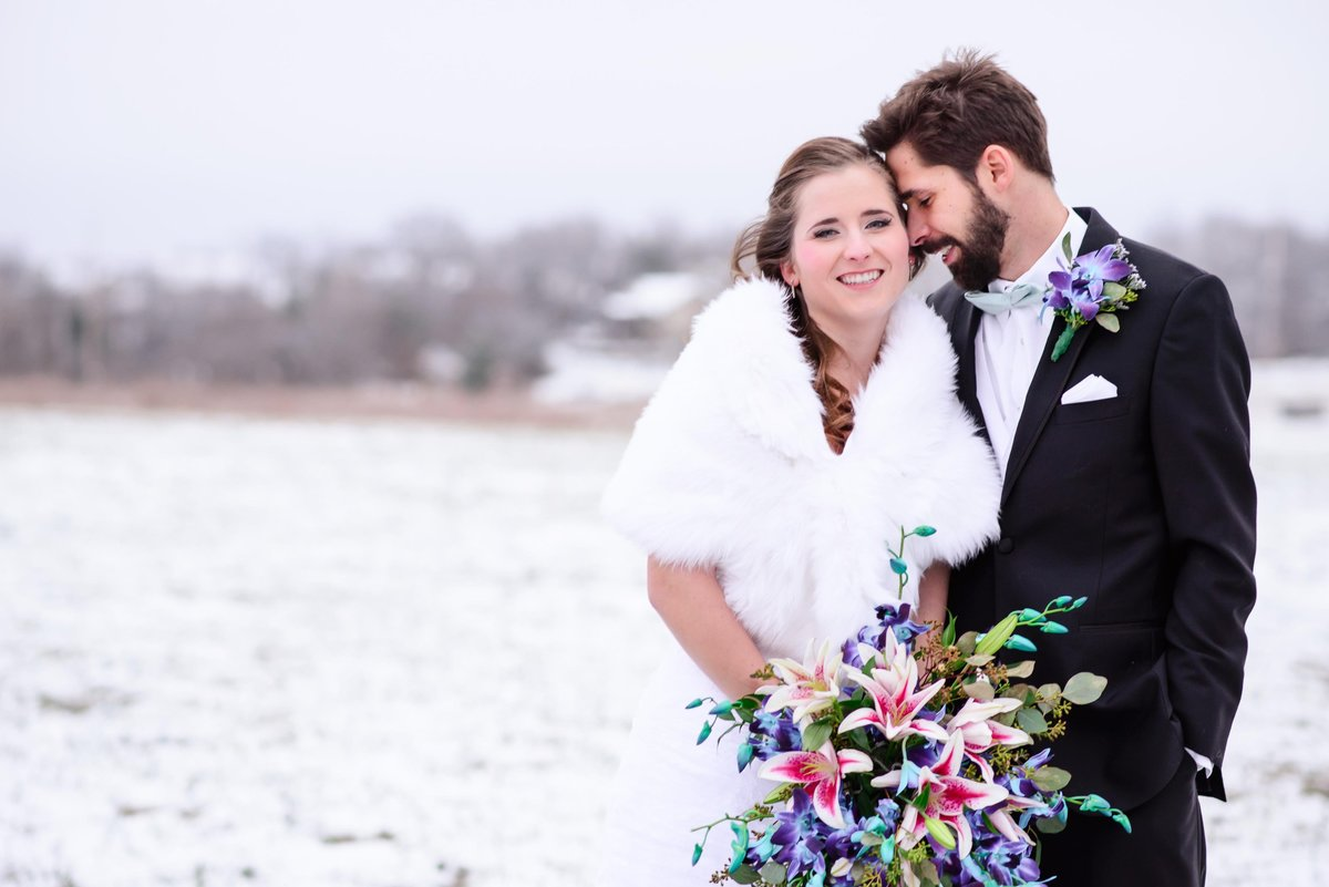 Snowy bride and groom portraits for St. Louis Winter Wedding