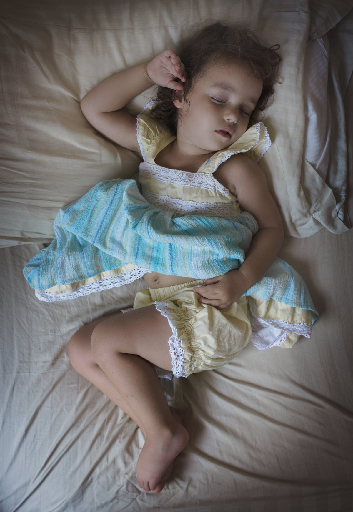 charlotte family photographer captures a beautiful lifestyle image of a toddler asleep in well dressed wolf