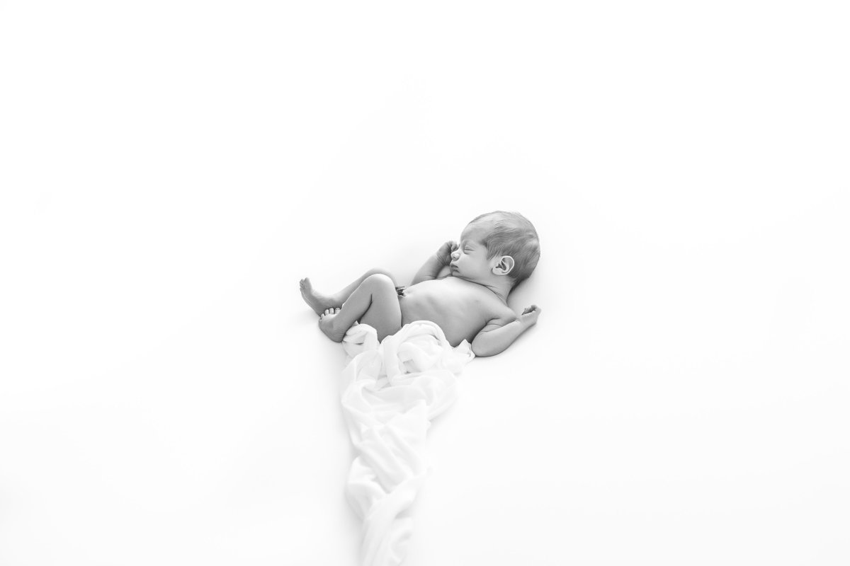 baby boy sleeping in a relaxed pose {Burlington Newborn Photographer}