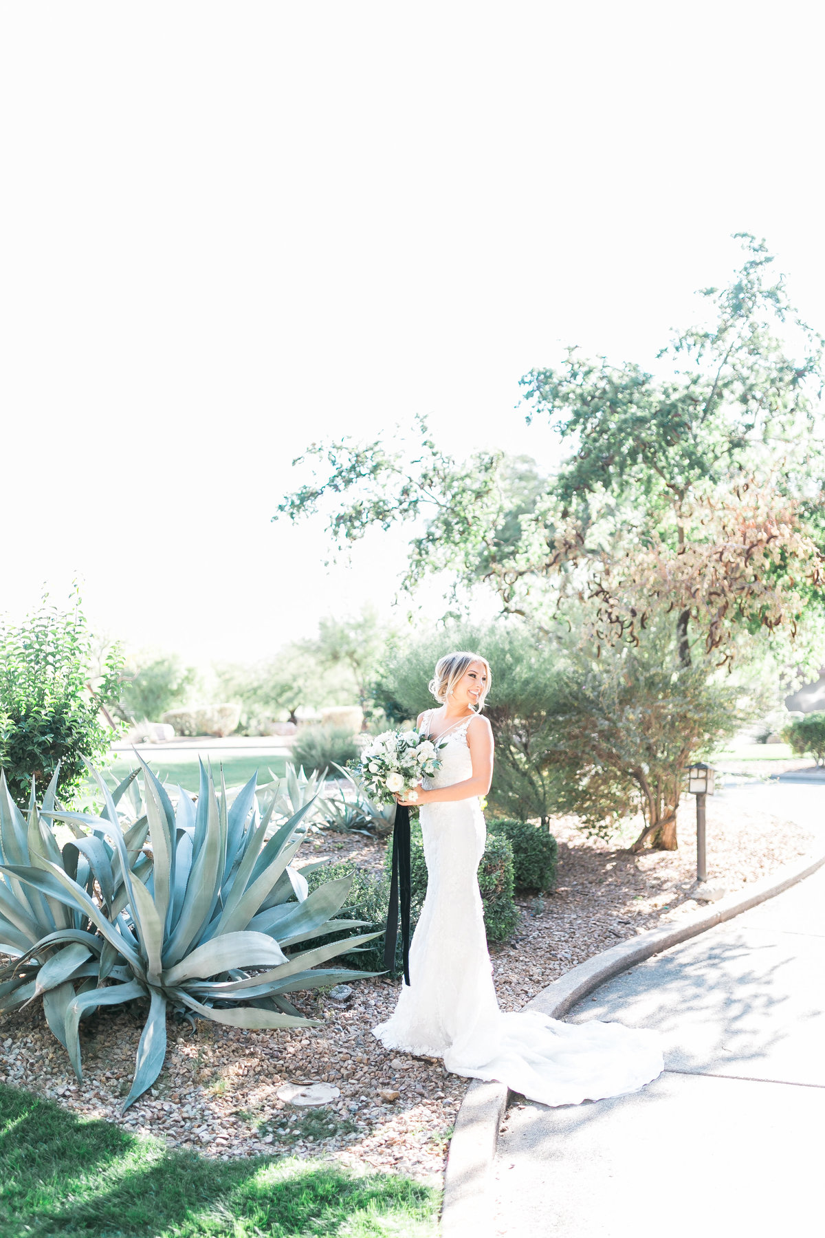 bride photo with white and greenery bouquet and black silk ribbon at Red Rock Country Club in Las Vegas