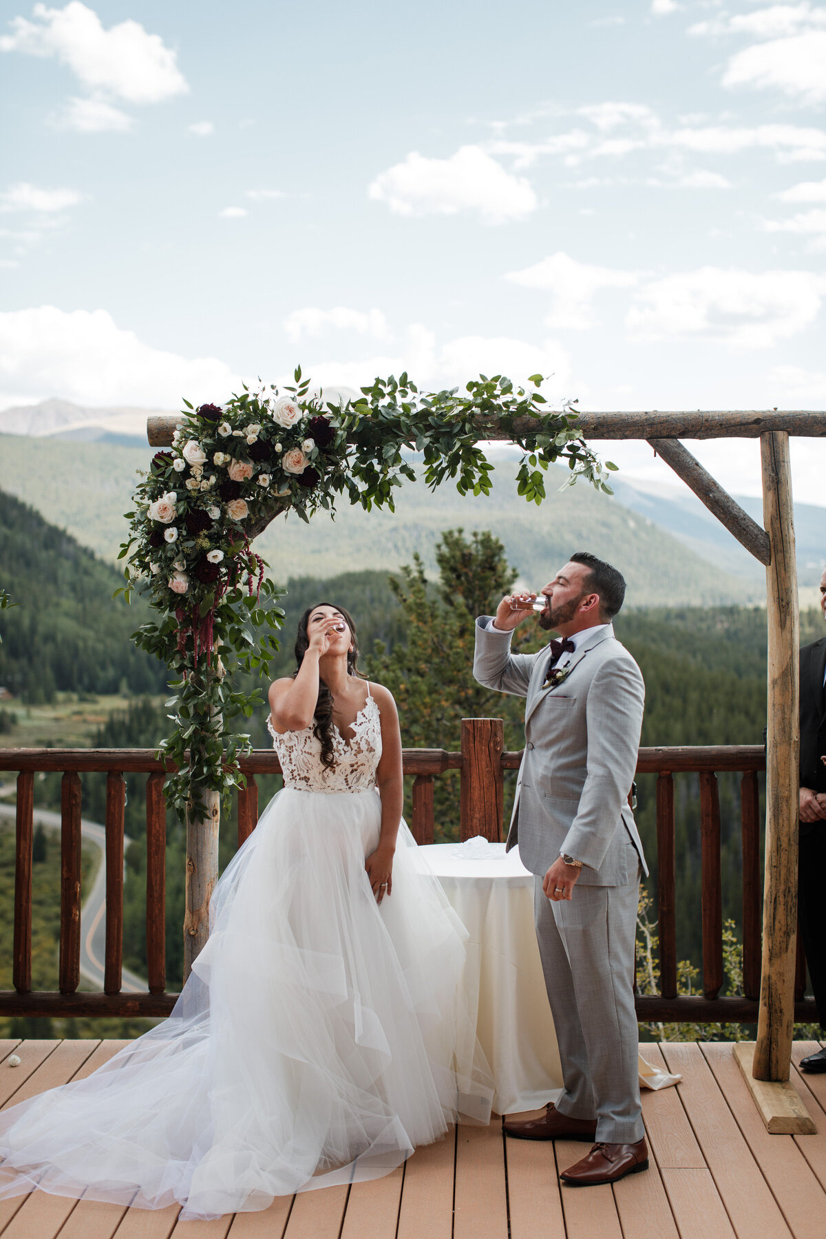 Couple takes a tequila shot in the middle of their wedding ceremony in Colorado